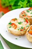 image of portobello mushroom  - Portobello mushrooms stuffed with mozzarella and cherry tomato