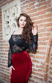 stock photo of playmate  - Charming young brunette woman in black lace blouse - JPG