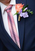 foto of fiance  - closeup of a fiance in suit with wedding flowers - JPG