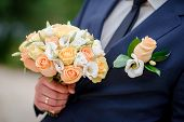 pic of fiance  - closeup of a fiance in suit with wedding flowers - JPG