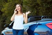 Caucasian Girl On A Cell Phone Service Or Tow Truck Traffic Near The Cabriolet Car
