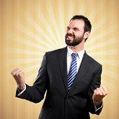 Young Business Man Winner Over Ocher Background