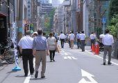 Japanese business people having lunch break