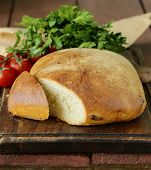 traditional Italian ciabatta bread with tomatoes and herbs