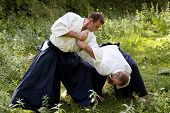 foto of aikido  - Training martial art Aikido. On nature. outdoors.