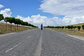 Child walking on a countryside road