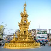 CHIANG RAI - JANUARY 10, 2014 : Street around golden clock tower, established in 2008 by Thai visual