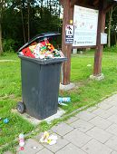 OFFENBERG, GERMANY - JULY 14 2014: Garbage and dirt on a pull off highway.  Routine situation every