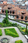LAUSANNE, SWITZERLAND - JULY 7, 2014: Gardens and city view at the Cathedral of Notre Dame of Lausanne. The church belongs to the Evangelical Reformed Church of the Canton of Vaud.