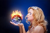 Frozen girl holding burning earth globe (west hemisphere) in palms (elements furnished by NASA) - ve