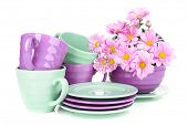 Bright dishes with flowers isolated on white