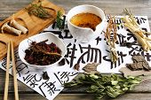 stock photo of hieroglyphs  - Traditional chinese herbal medicine ingredients with not real hieroglyphs - JPG