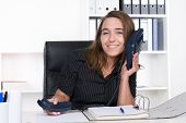 Young Woman Is Holding A Telephone At Her Ear
