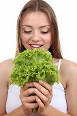 Beautiful girl with fresh lettuce, isolated on white