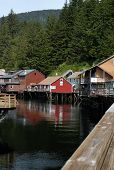 stock photo of curio  - Visited by thousands of visitors every year, historic Creek Street Ketchikan Alaska is one of the most popular things to do in Ketchikan. The antique boardwalk on wooden pilings over Ketchikan Creek is home to restaurants, unique curio shops, the 