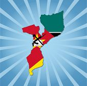 Mozambique map flag on blue sunburst illustration