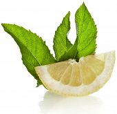 Fresh lemon with mint leaf isolated on white background