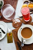 Coffee, water and watermelon juice on a table