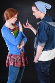 stock photo of polite girl  - Polite teenage girl refusing drugs from naughty boy - JPG