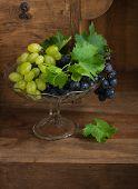 Grapes In Glass Vase