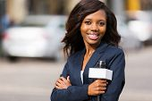 portrait of beautiful african news reporter standing outdoors