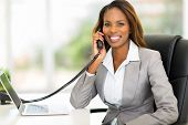 attractive african american office worker talking on the phone
