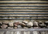 foto of old stone fence  - old wall out of clay and stones