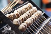 Thai Meat Ball With Bamboo Stick On The Stove