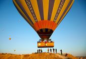GOREME, TURKEY - AUGUST 25: Hot air balloon fly over Cappadocia on august 25, 2013 in Goreme, Cappad