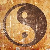 foto of yin  - Yin yang symbol on grunge background with stains - JPG