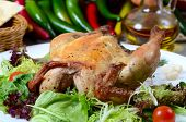 The baked hen with salad close up