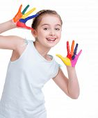 Happy pretty little girl with painted hands - isolated on white.