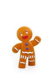 stock photo of gingerbread man  - Plastic gingerbread man isolated on white background - JPG