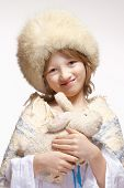 pic of stuffed animals  - Christmas Portrait of a Boy with Fluffy Hat and Stuffed Animal - JPG
