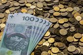 stock photo of zloty  - Zloty the currency of Poland on the table - JPG