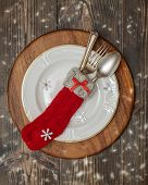 Antique cutlery in Christmas stocking place setting