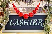 Cashier Plate With Christmas Decorations And Red Balls