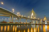 Suspension bridge (Bhumibol bridge) with street light reflect
