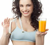 head and shoulders portrait of attractive  caucasian smiling woman isolated on white studio shot drinking orange juice face skin