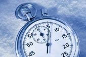 image of stopwatch  - Stopwatch on snow in blue toning in closeup - JPG
