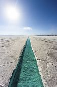 stock photo of salt mine  - Salt water pool on the Salinas Grandes salt flats in Jujuy province northern Argentina - JPG