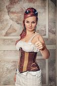Beautiful Steampunk Woman Showing Thumbs Up Gesture