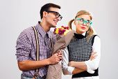 image of forgiveness  - Nerdy man is giving a bouquet of flowers to his girlfriend - JPG