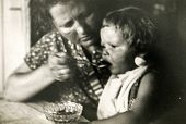 GERMANY, CIRCA 1938 -  Vintage photo of mother feeding her baby girl