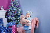 Little Boy Near Christmas Tree