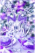 Christmastime still life, abstract New Year greeting card, reindeer baubles in wineglasses, romantic dinner on Christmas eve