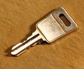 Metal Key On Paper Background