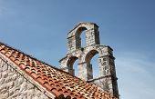 BUDVA, MONTENEGRO - JUNE 09, 2012: The bell tower of the church of Saint Mary in Punta, Budva, Montenegro, on June 09, 2012.