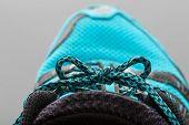 Blue shoelaces on grey
