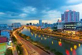 Ho Chi Minh Riverside cityscape night view with Ben Nghe or Tau Hu canal and calmet Bridge
